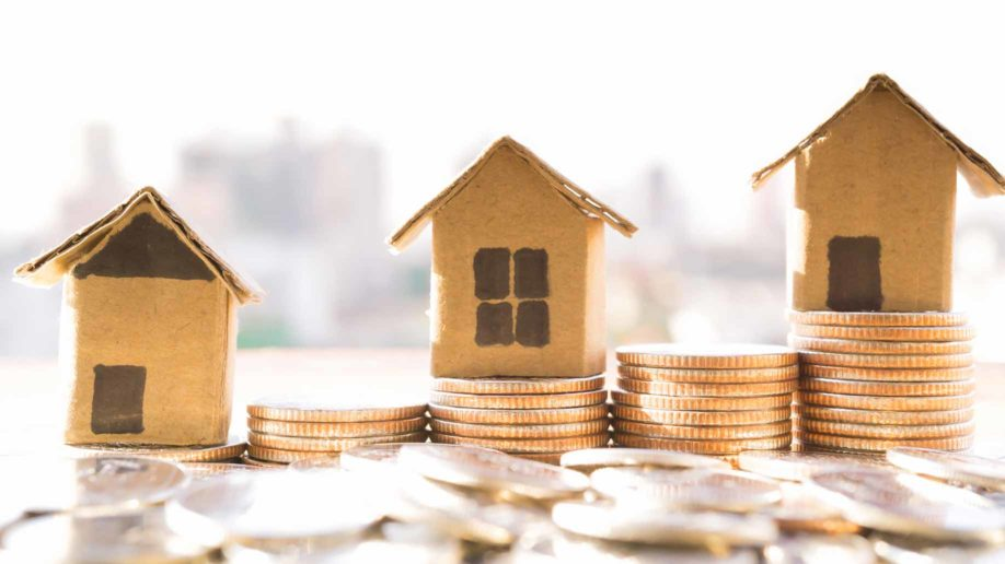 carboard houses coins housing costs