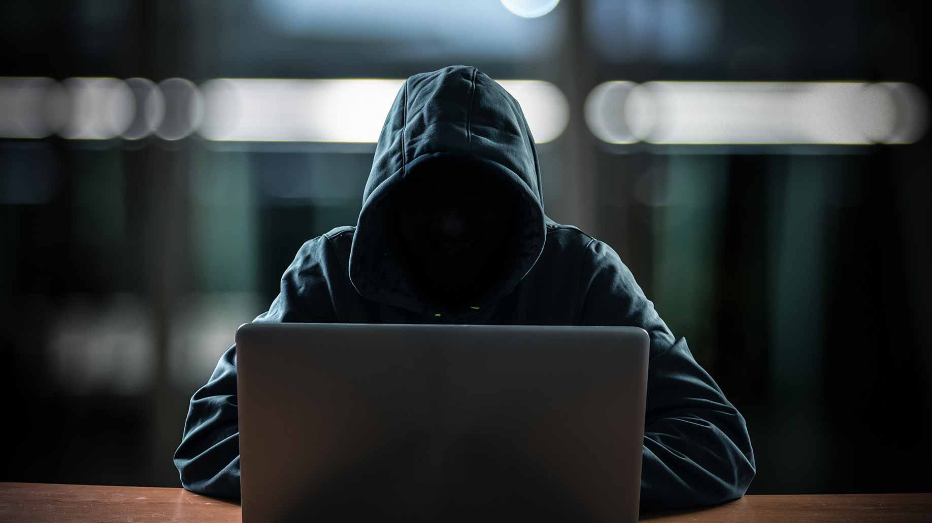 hooded hacker computer spyware