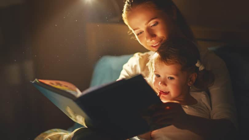 mother daughter reading bedtime story